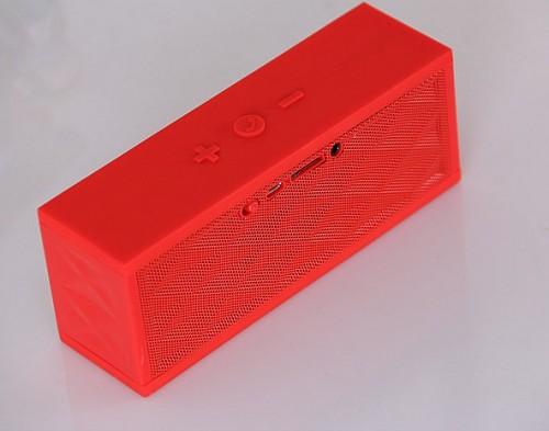 red wireless bluetooth speaker with logo